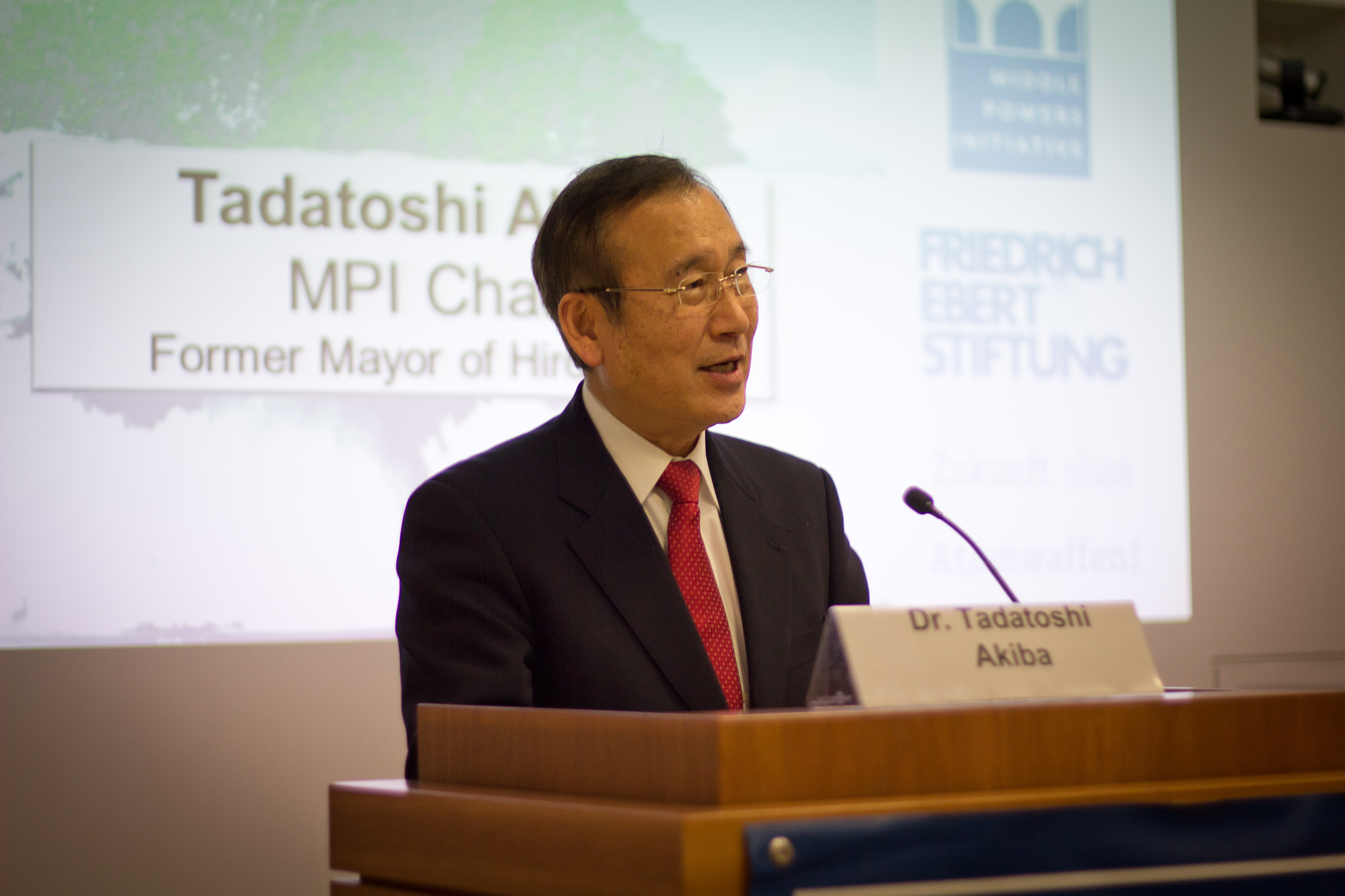 Tad Akiba, chair of the MPI, speaking at the public session